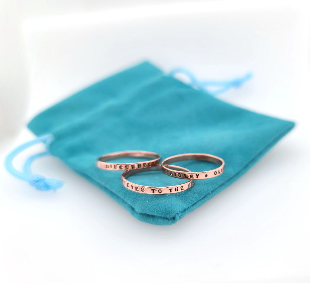 thin copper rings handstamped with messages