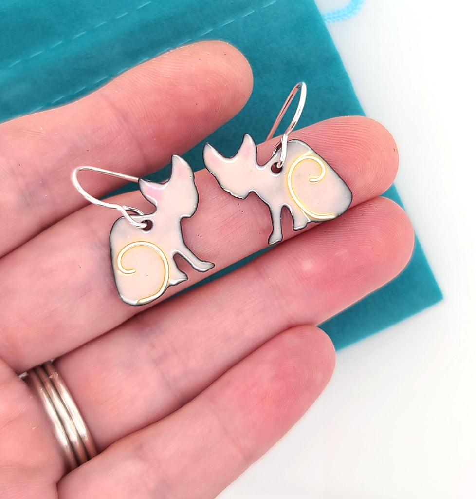 pink hairless cat earrings by Kathryn Riechert