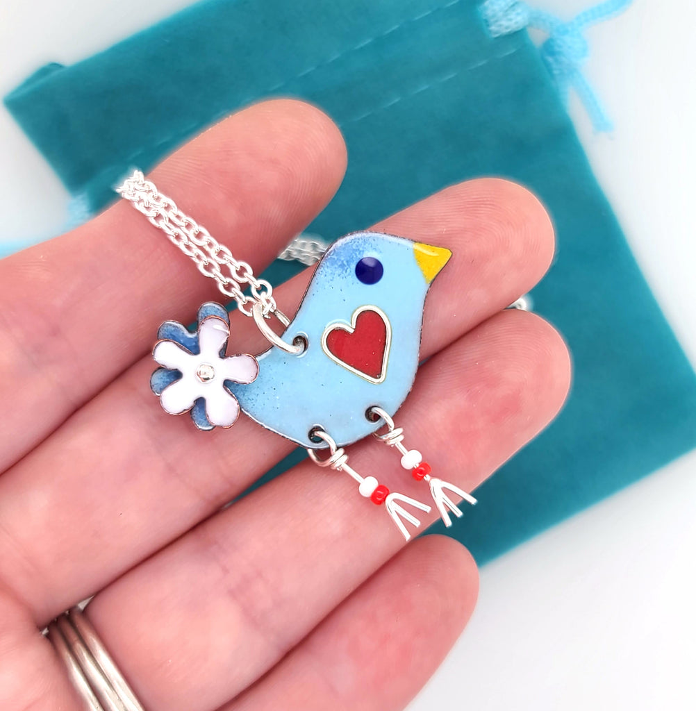 handcrafted bird charm with white flower tail