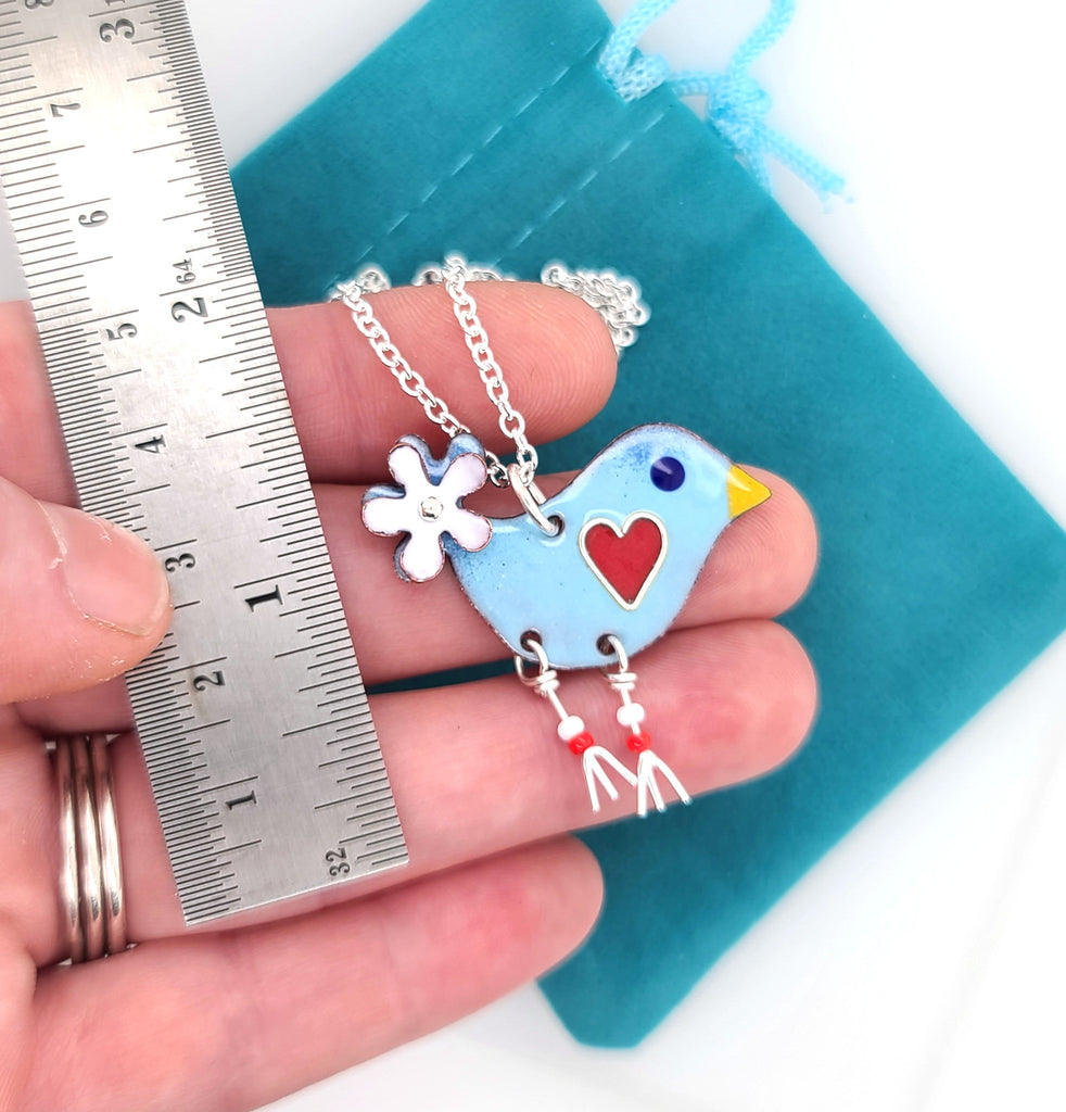 blue bird charm by ruler for scale