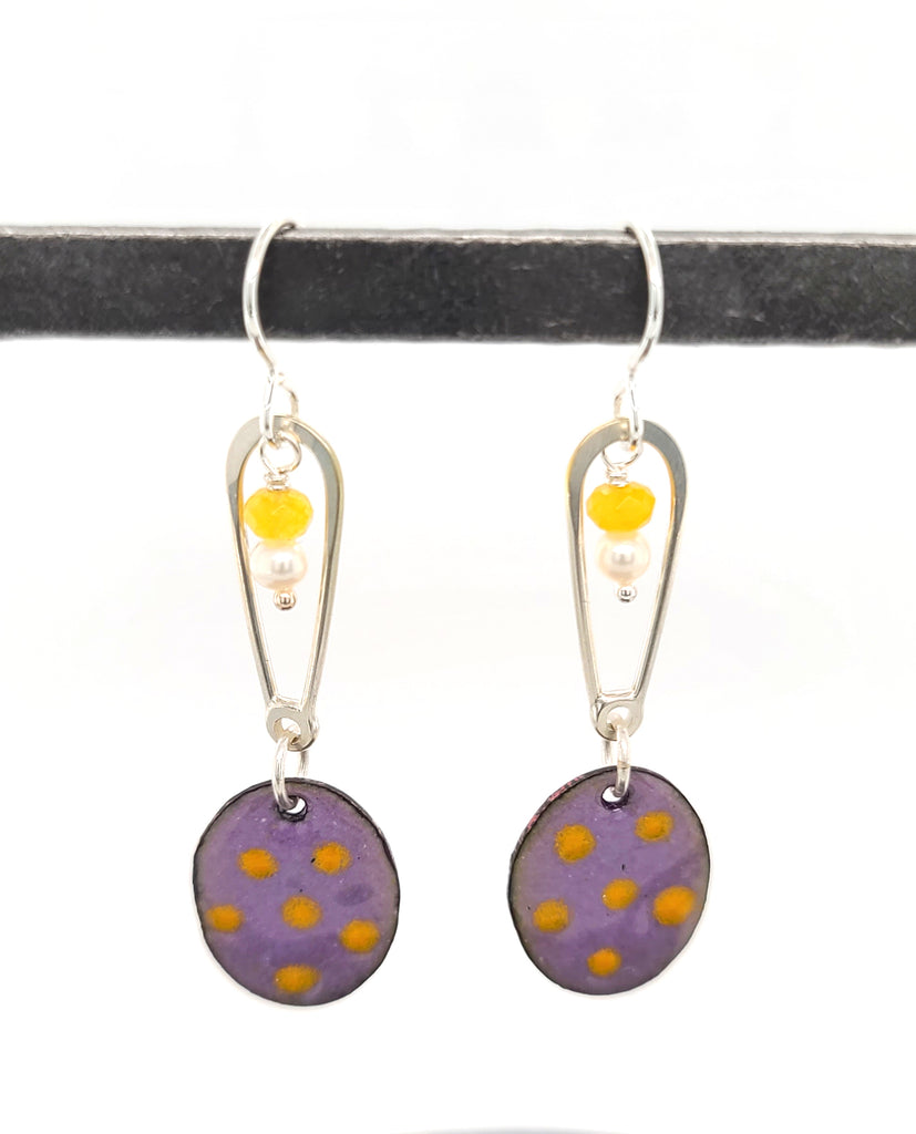 long enameled earrings with oval drops