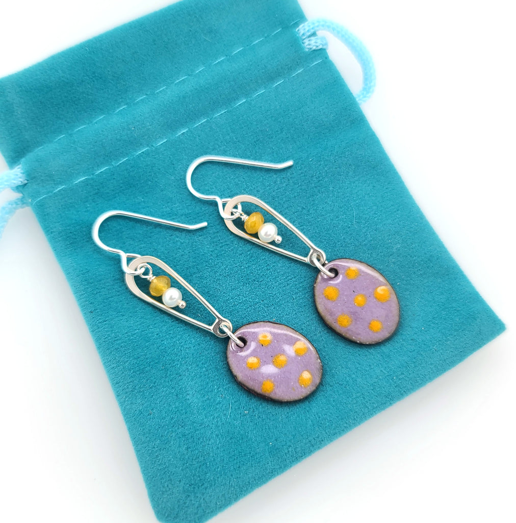 purple and yellow earrings with pearls