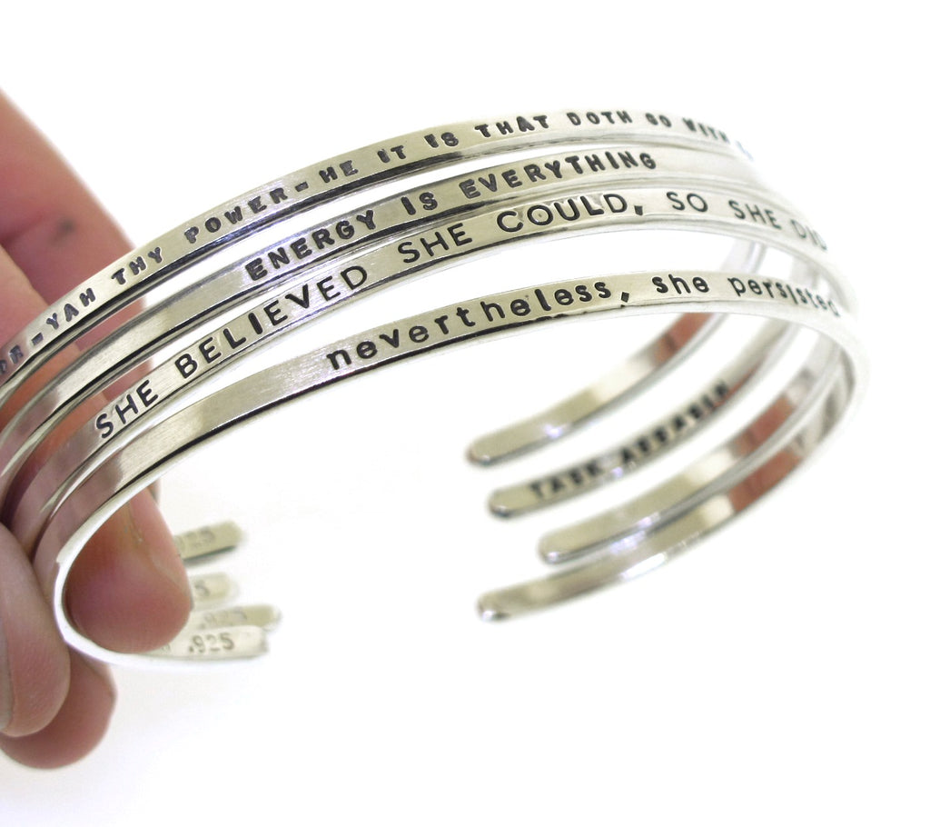 inspirational messages handstamped on custom silver cuff bracelets made by kathryn riechert jewelry