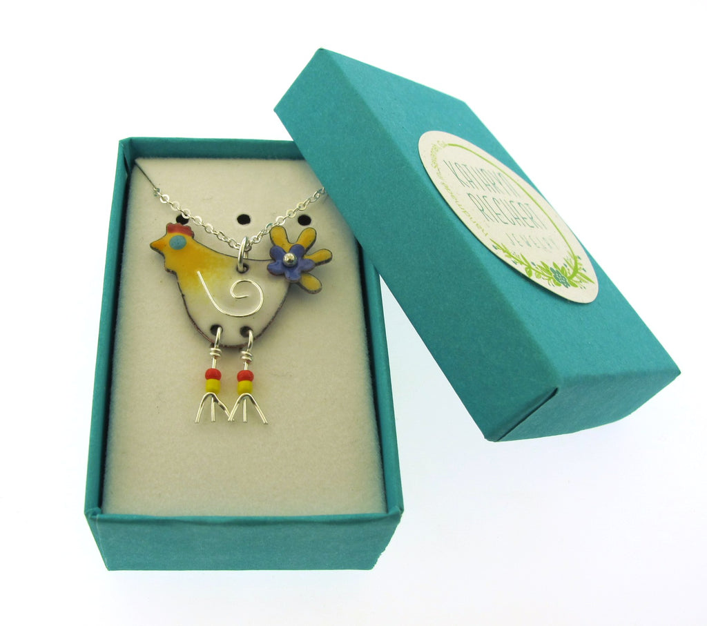 yellow and white chicken pendant