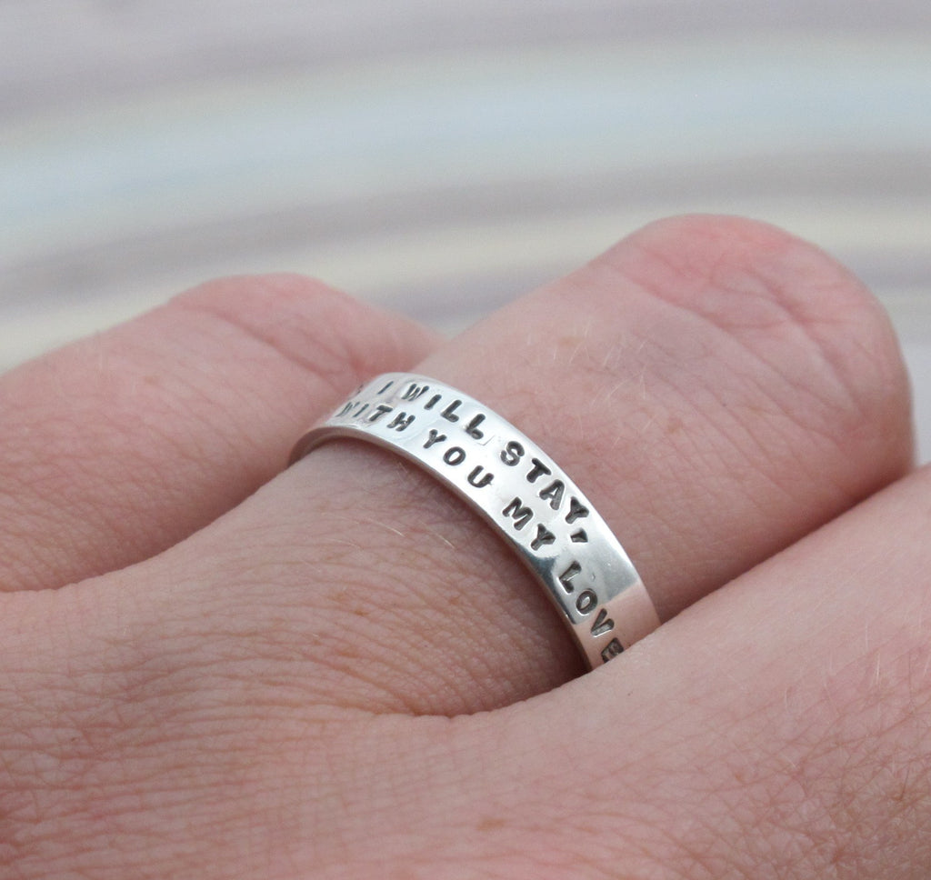 silver ring with 2 lines of lettering