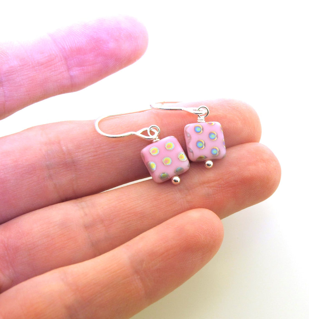 pink square earrings with dots