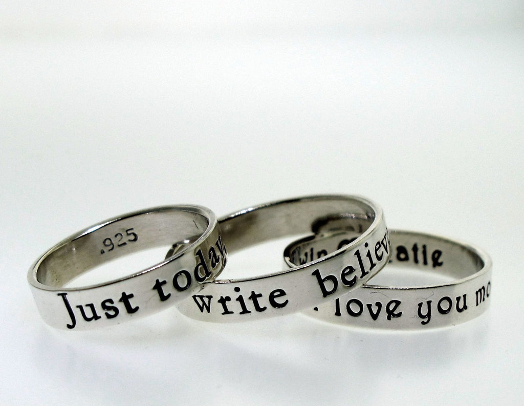 inspirational words on handcrafted silver rings by kathryn riechert jewelry