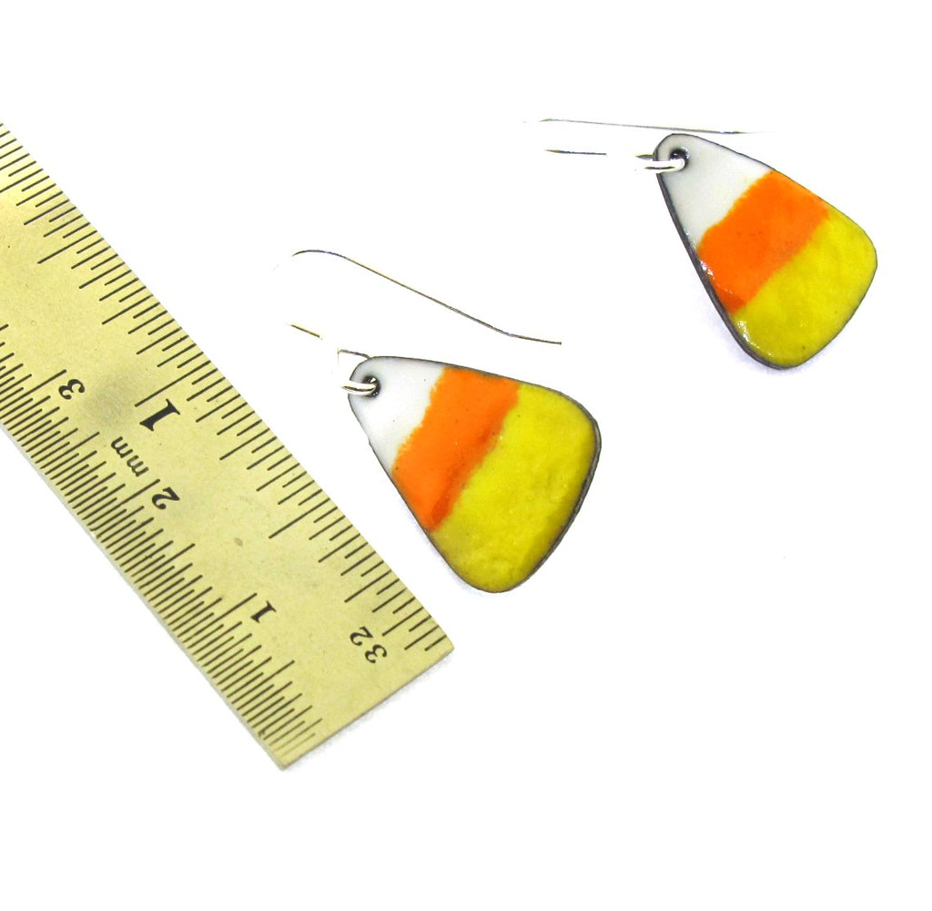 white, orange, and yellow enameled earrings