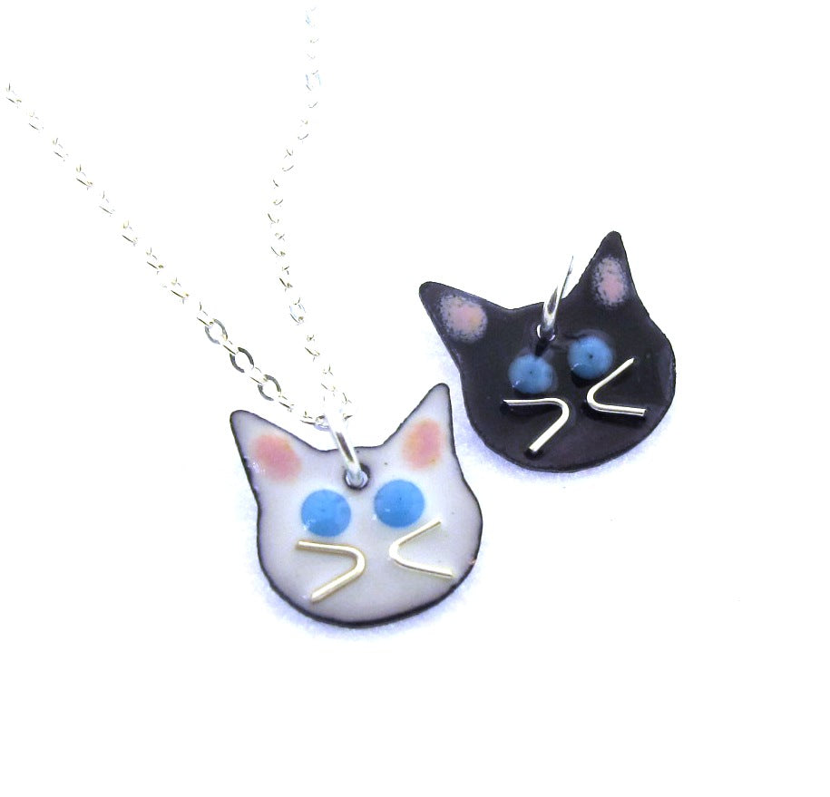 white cat necklace, black cat