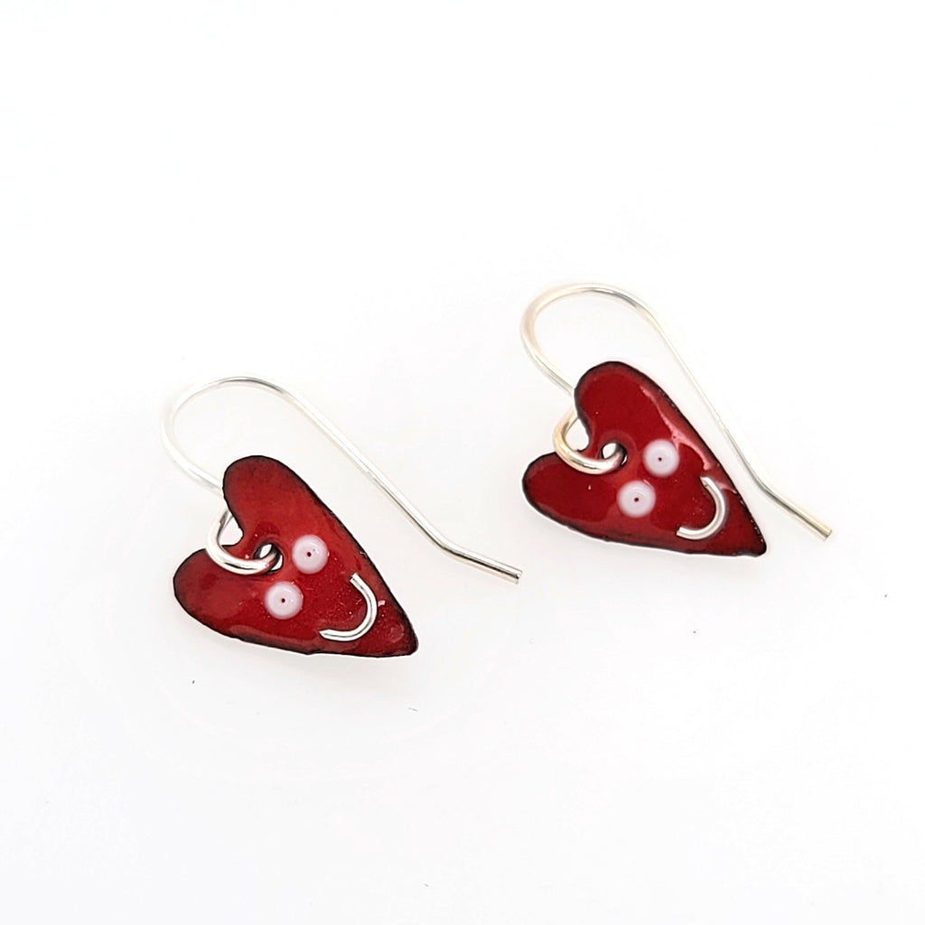 red heart earrings with smiley faces
