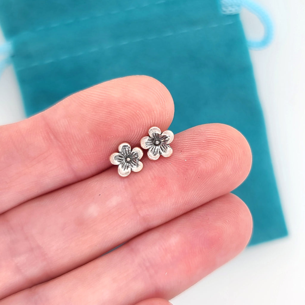 tiny silver flower earrings on posts