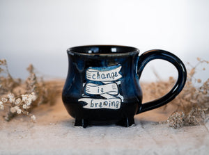 Change is brewing in blue cauldron mug 2