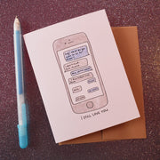 "Card with a cellphone showing a text conversation between lovers, saying ""Hey! What do you want to do for dinner? -I don't mind. You choose. -How about pizza? -I don't feel like pizza. -Tacos? -Nah? -Ok. Pasta? -Not pasta."" The words ""I STILL LOVE YOU"" are underneath the cellphone."