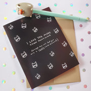 "Black and white card with cat head drawings all over and the words, ""I love you more than anything (except the cat, but you are a really close second.)"
