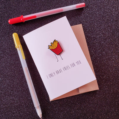 White card with a soft enamel pin of Kawaii french fries, with the words on the card, saying