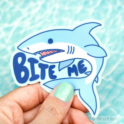 Shaped sticker of a light blue and white Great White shark with the words,