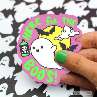 Shaped sticker of a cartoon ghost, holding a green bottle of an adult beverage that has a skull on it. A full yellow moon, with black bats sit behind the ghost with the words,