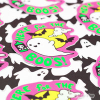 "Several shaped stickers of a cartoon ghost, holding a green bottle of an adult beverage that has a skull on it. A full yellow moon, with black bats sit behind the ghost with the words, ""Here for the Boo's"" in lime green caps. Black background with white ghosts behind sticker."