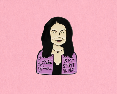 enamel pin with orelai Gilmore, her pink shirt says,