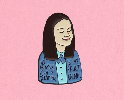 enamel pin with Rory Gilmore, her blue shirt says,