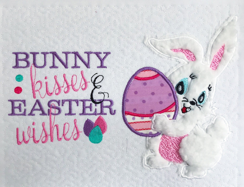 Easter bunny holding egg Applique design and bunny kisses & Easter wishes Embroidery Saying