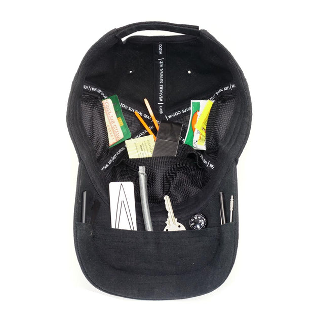 inside of black cache cap showing actual items placed into each of the pockets on the inside of the hat