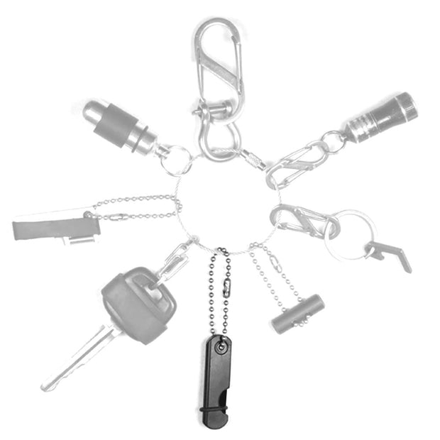 folding ceramic knife with keychain and o-ring band on a keychain with keys mini flashlight carabiner and small survival tools
