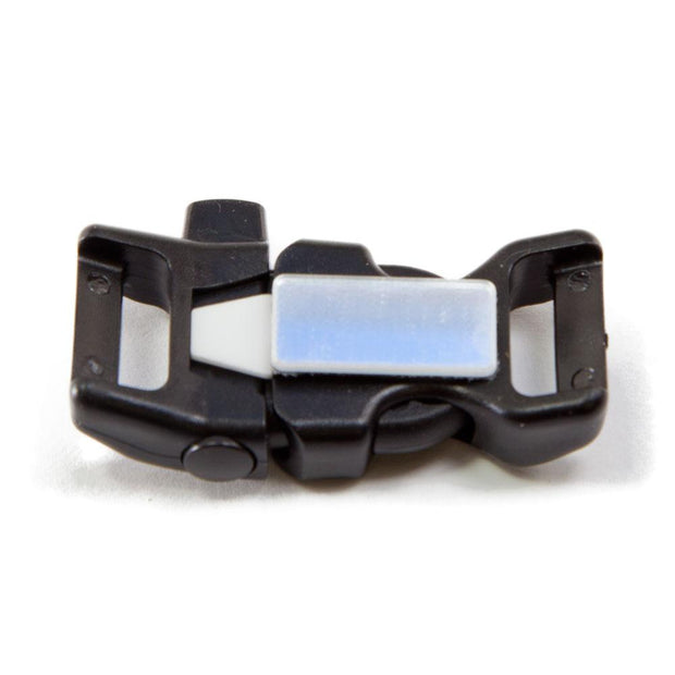backside of a closed buckle with ceramic scraper whistle and signal mirror that faces wrist side down used for survival bracelets