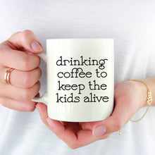 Load image into Gallery viewer, Drinking Coffee to Keep the Kids Alive