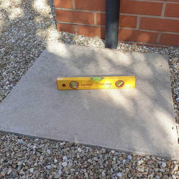level paving slab laid for a water butt stand