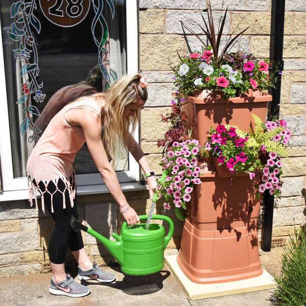 terracotta water butt with planters 100-200 litres, girl filling watering can