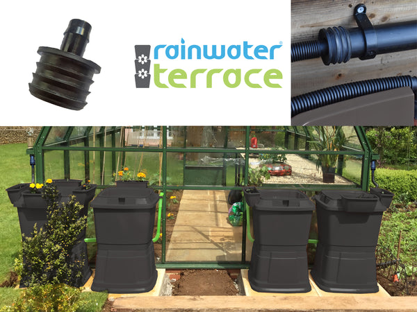 Greenhouse with 40mm downpipe adapter attached to guttering with 2 low level 134 litre black waters butts