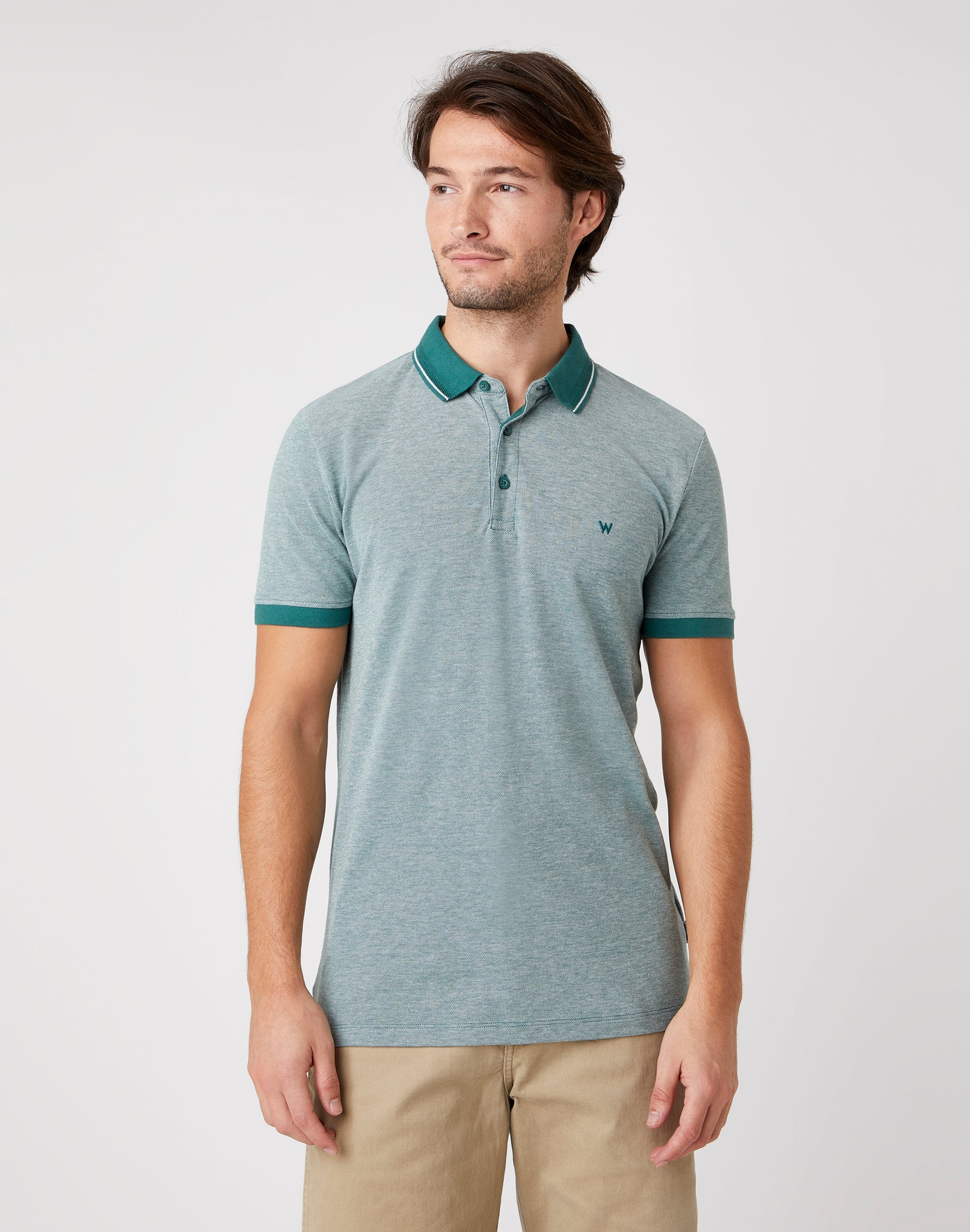 Organic cotton short sleeve polo shirt with regular fit in green with dark green collar and hems by iconic USA brand Wrangler.