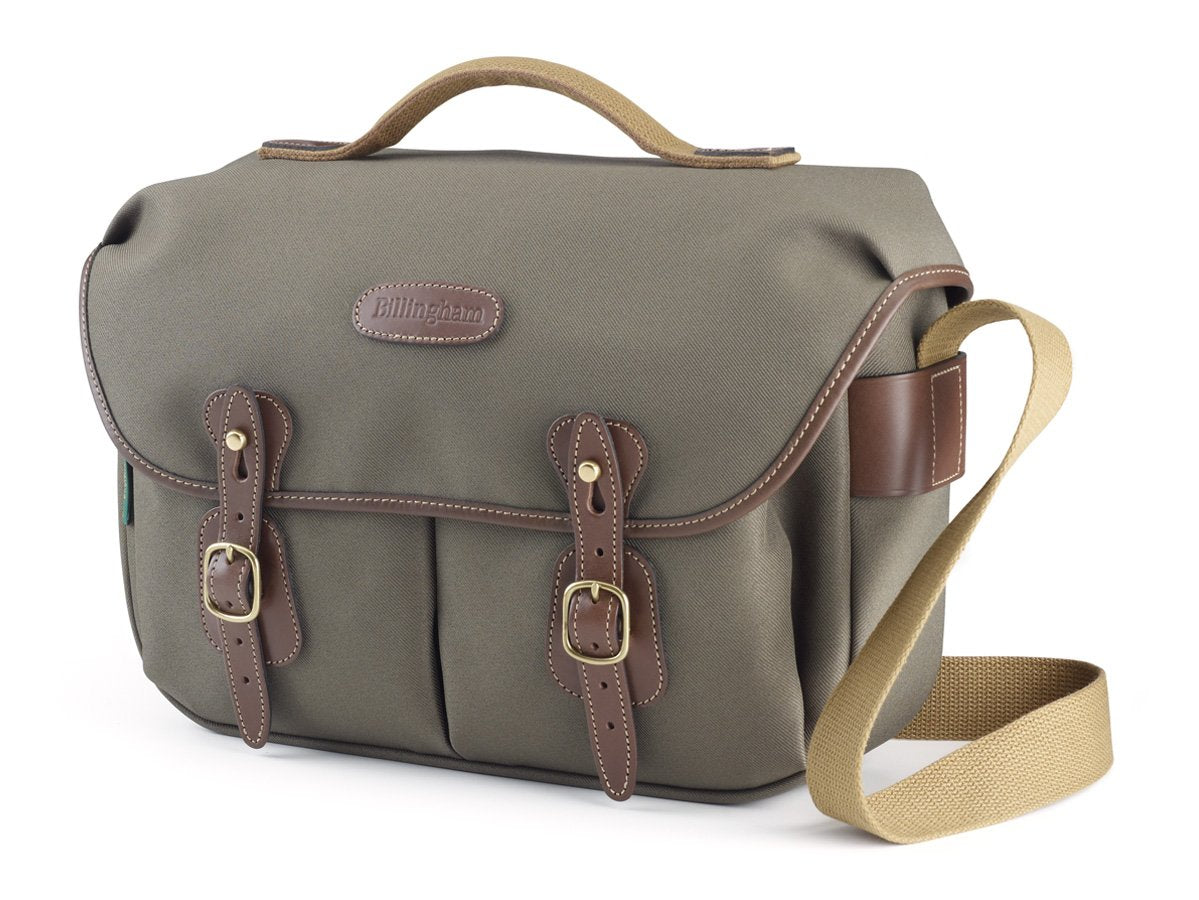 Travel, luggage and camera bag with removable padded insert for camera storage from Great British travelware experts Billingham, featuring waterproof composition, real grain leather, brass fittings and 5-year guarantee.