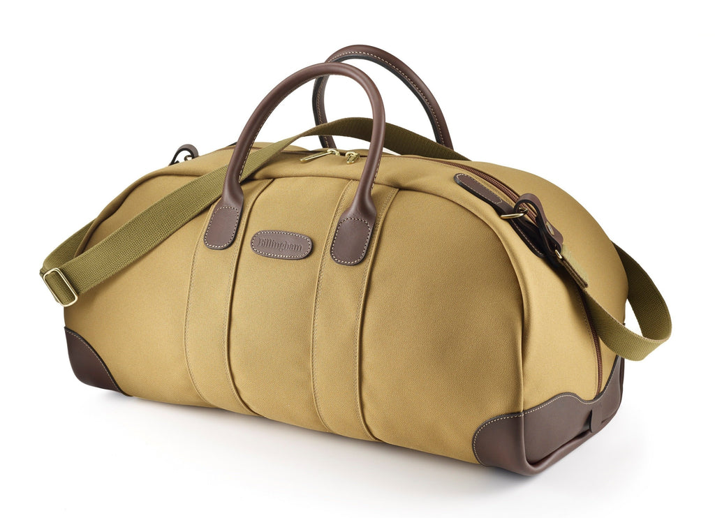 Travel bag weekender size in khaki from Great British travelware experts Billingham, featuring waterproof composition, real grain leather, brass fittings and 5-year guarantee.