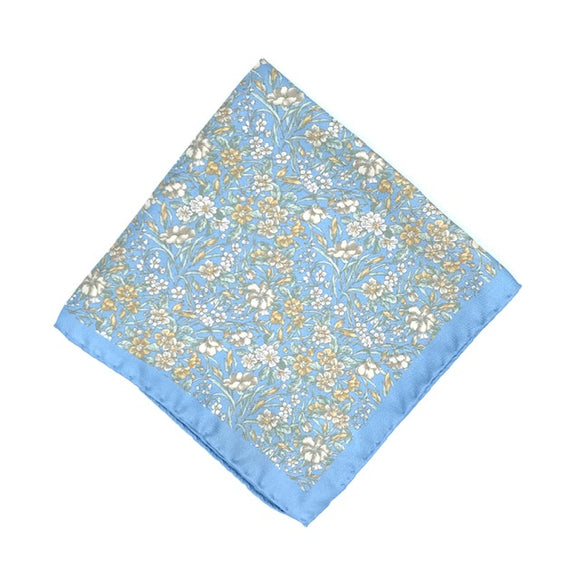 Luxury silk pocket square designed and crafted exclusively for Regent, featuring a blue silken background with finely illustrated daisies. Excellent for spicing up a suit pocket on any occasion - versatile, understated and smart. Super soft, durable and unique.