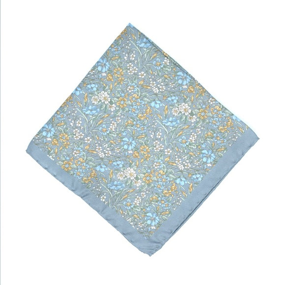 Luxury silk pocket square designed and crafted exclusively for Regent, featuring a slate blue silken background with finely illustrated daisies, bugloss and other spring flowers. Excellent for spicing up a suit pocket on any occasion - versatile, understated and smart. Super soft, durable and unique.
