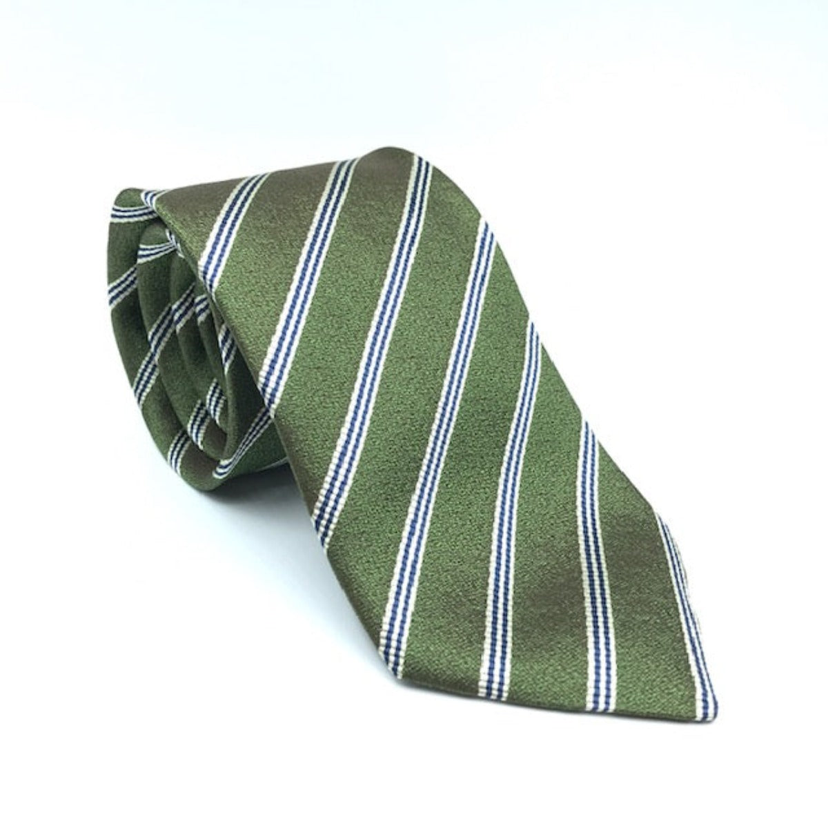 A luxury silk tie designed by and handmade exclusively for Regent. A mossy green is electrified by smart back thin twin lines for a classic yet unusual finish.