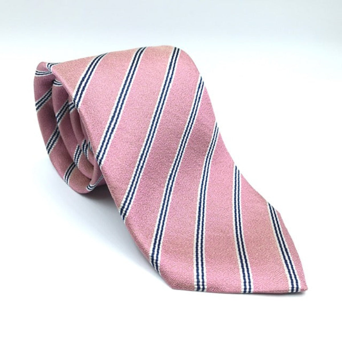 A luxury silk tie designed by and handmade exclusively for Regent. A subtle pink is electrified by smart back thin twin lines for a classic yet unusual finish.