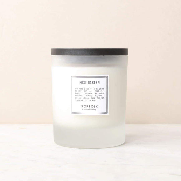 Rose-scented candle with 50oz (10-hour) burning capacity. Naturally, subtly scented with rose and inspired by the floral scent of an English country garden in full bloom, the candle is hand-poured with natural wax in a small workshop on the Norfolk coast.