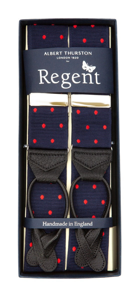 Ribbed silk braces in navy with red spot with nickel fittings and black leather ends, designed and made in the UK exclusively for Regent.