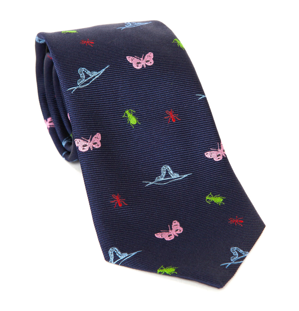 Luxury silk tie designed and crafted in England exclusively by Regent, featuring an 8cm blade width and five insect types – chosen by Mr. Regent's son – over a rich navy background.
