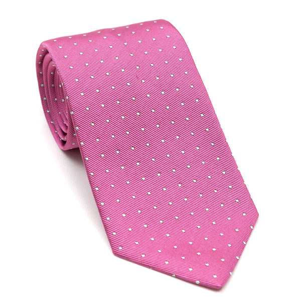 A luxury silk pink tie with white spots designed by and handmade exclusively for Regent.