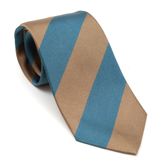 A luxury silk tie designed by and handmade exclusively for Regent. Rich Mediterranean blue and burnt gold stripes combine for a peaceful, calming finish - great with a black or brown suit.