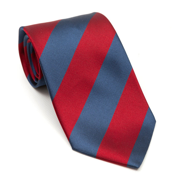 A luxury silk tie designed by and handmade exclusively for Regent. Deep slate blue and cherry red stripes combine for a striking, authoritative finish - great with a darker suit to add a dash of pizzazz.
