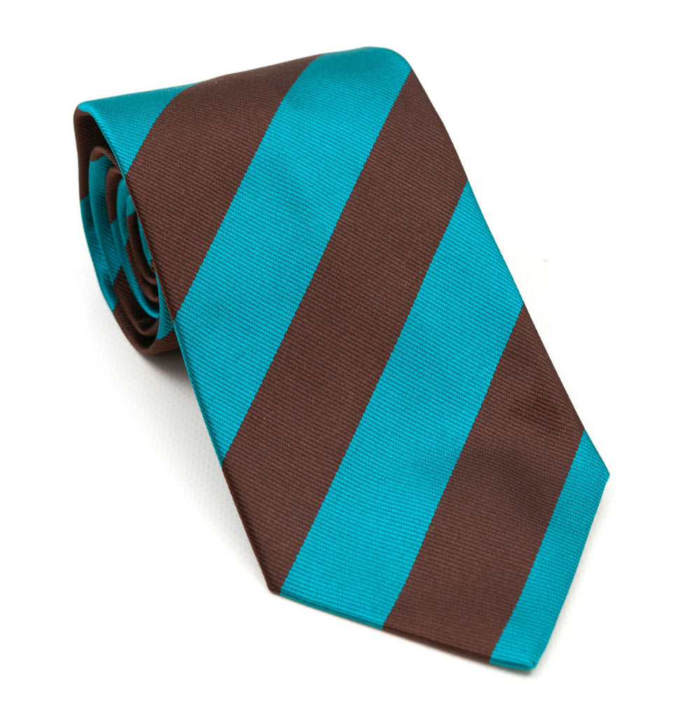 A luxury silk tie designed by and handmade exclusively for Regent. Spring sky blue combines with an earthen, chocolate brown for a rugged and charming finish.