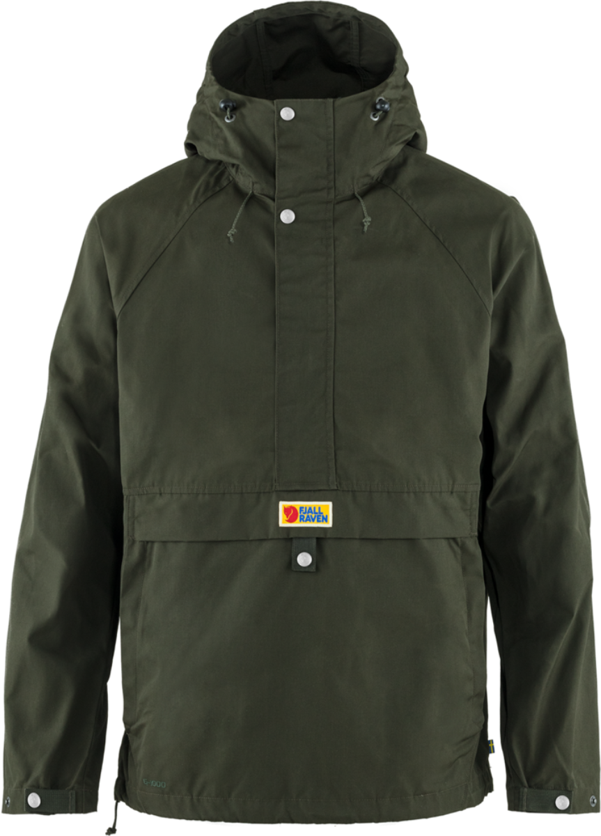 Water- and wind-proof classic anorak-style coat from Fjallraven in deep green and featuring recycled composition, adjustable hood, long zipper design and buttoned front placket.