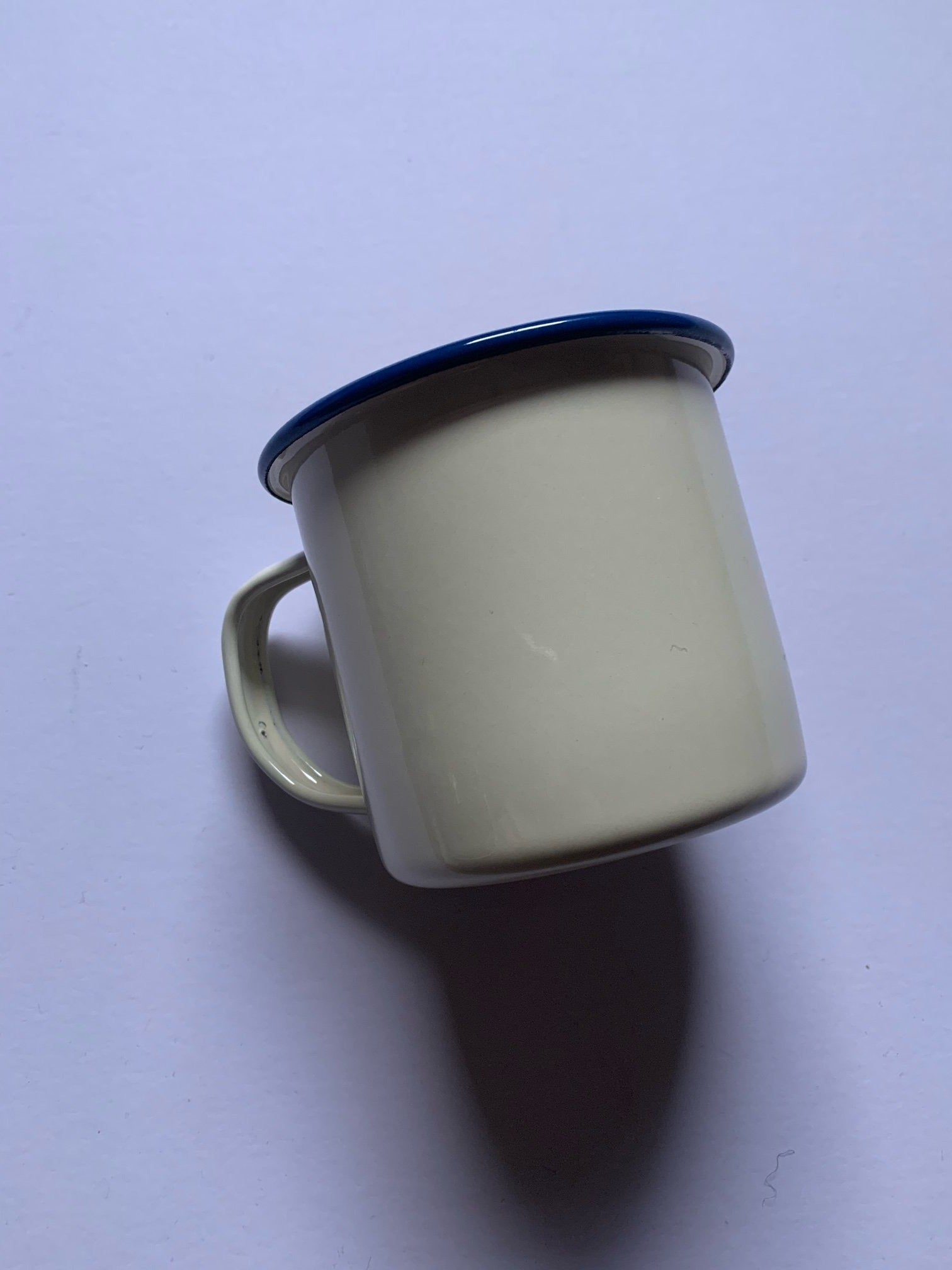 White enamelware mug which is durable, practical and travels well. Iconic, aesthetic and practical, it's the perfect cup for your morning brew, whether at home or out on the trail, and the look fits well into any homestead, making a great gift for those newly renting or home-owning.