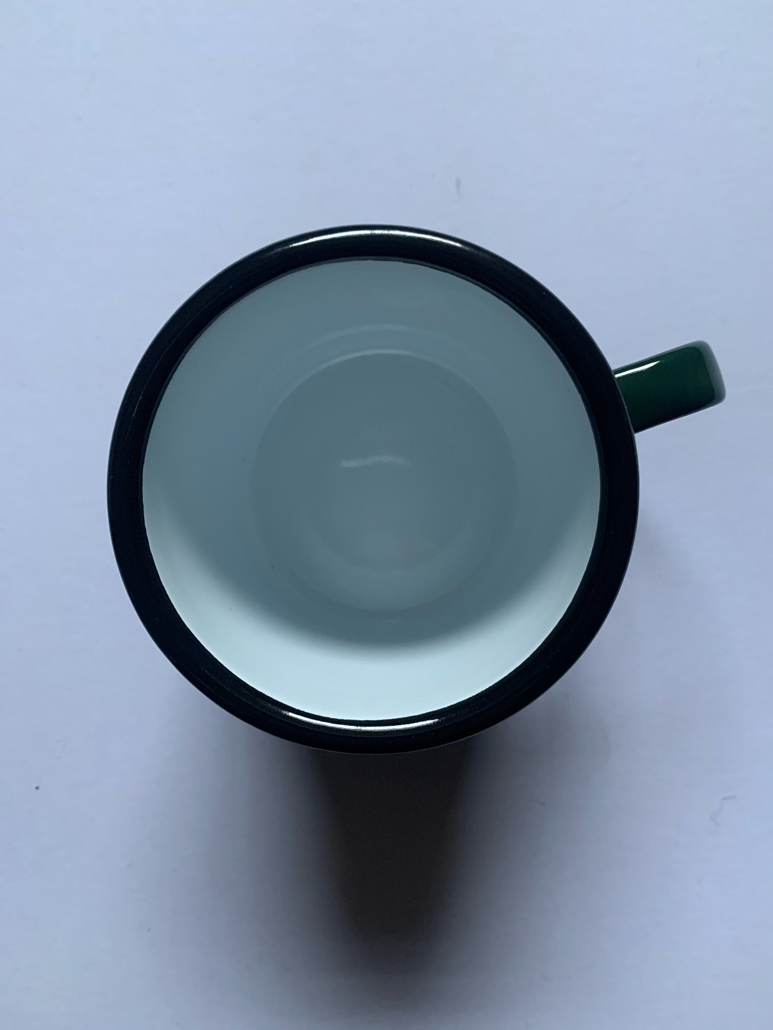 Green enamelware espresso cup from original enamelware brand Falcon which is oven, dishwasher, freezer, electric and gas hob friendly.