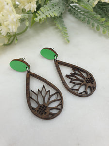 Sunflower wooden earrings in a tear drop shape and paired with a hand painted green piece. Hypoallergenic posts and made from queensland walnut.